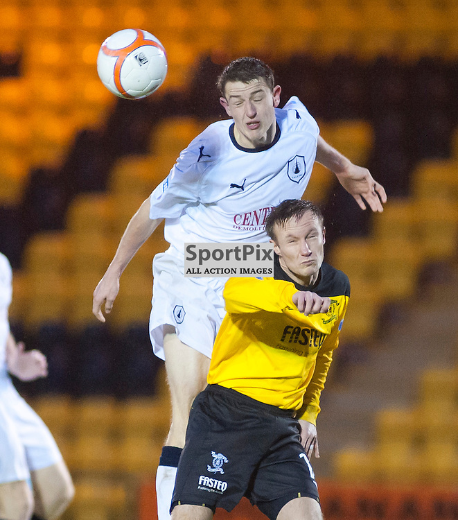 Falkirk's Murray Wallace wins a header against Iain Russell, Livingston v Falkirk, SFL Division 1, Braidwood Motor Company Stadium, Monday 2nd January 2012