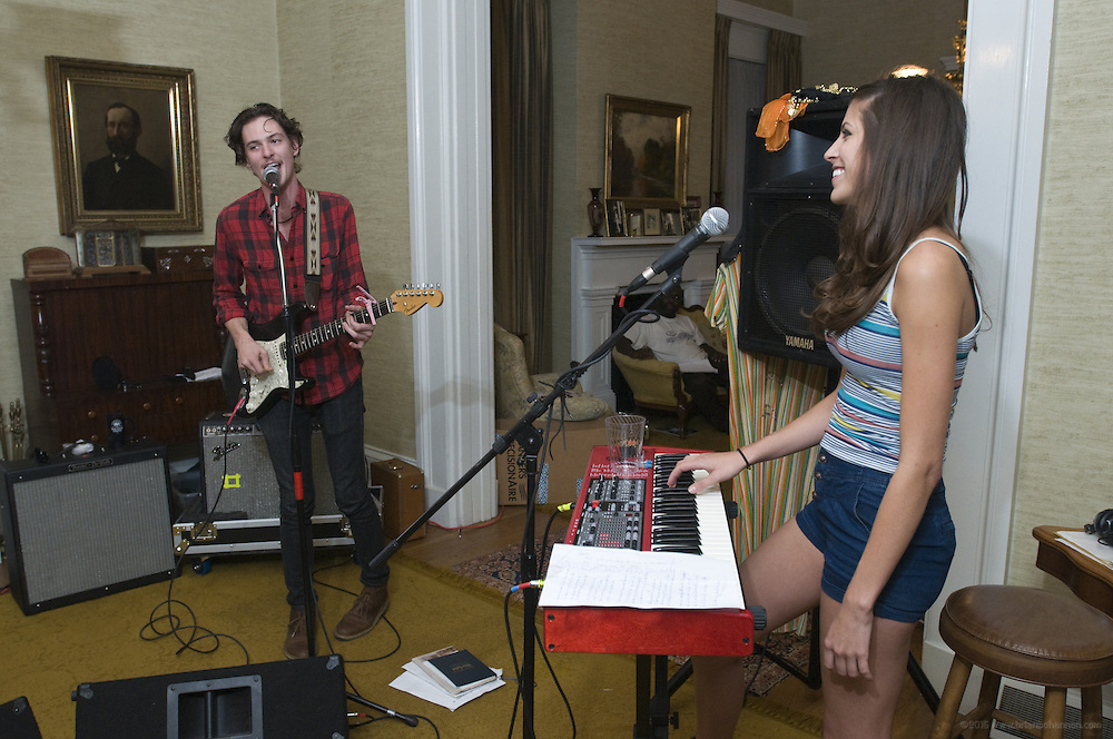 Houndmouth guitarist Matt Myers and keyboardist Katie Toupin practice at the home of drummer Shane Cody, Friday, Aug. 17, 2012, in New Albany, Ind. The group, which also includes bassist Zak Appleby, gained national attention after they uploaded their songs to the Internet earlier this year. Houndmouth's online success story is an indicator of how the music business is changing, and how the Louisville music scene continues to thrive. (Photo by Brian Bohannon)