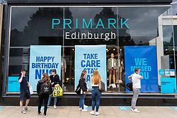 Edinburgh, Scotland, UK. 24 July, 2020. Social distancing in queue outside Primark on Princes Street in Edinburgh. Iain Masterton/Alamy Live News