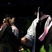 Juan Luis Guerra felicita a Kin Jun Seo, de Korea  durante la reciente.graducion en la Universidad de Berklee, Mayo 2009. En el mismo acto,Guerra.fue envestido con titulo honorifico de Doctor, por sus trunfos e influencia en la musica internacional...