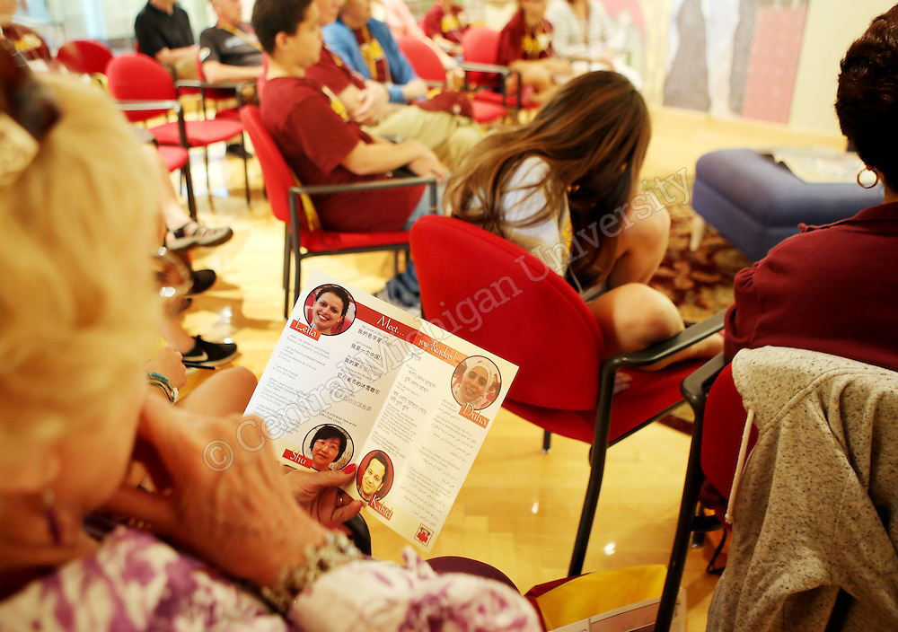 A woman reads the International Children's Book Read In program during a Grandparents U session photo by Emily Mesner