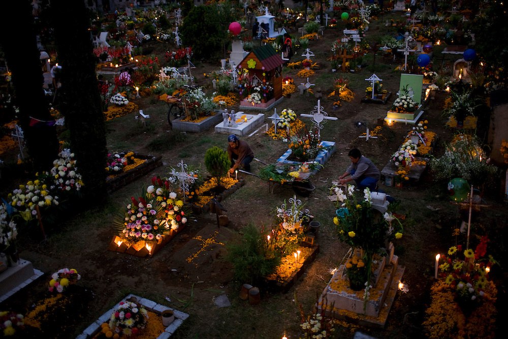 People visit a cemetary to honor the relatives during Mexico's Day of the Dead