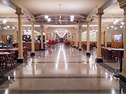 """16 MARCH 2020 - DES MOINES, IOWA: The deserted main hallway, near the public entrance in the basement of the Iowa State Capitol in Des Moines. Because of numerous reports of Coronavirus in Iowa, the governor is suspending the legislative session for 30 days. It was scheduled to run until mid-April. Sunday night, the Governor announced that the state health department had recorded """"community spread"""" in Des Moines. As a result the State Capitol instituted mitigation measures that included mandatory health screening for everyone going into the building, canceling group tours of the building, and closing the souvenir shop and snack bar.      PHOTO BY JACK KURTZ"""