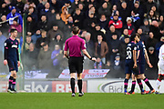 The referee holds up play as a flare goes off in the Portsmouth end during the EFL Sky Bet League 1 match between Milton Keynes Dons and Portsmouth at stadium:mk, Milton Keynes, England on 10 February 2018. Picture by Dennis Goodwin.