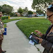 NORTH MIANI, FLORIDA, NOVEMBER 8, 2016<br /> Move On volunteers Lorna Shuford, right,  and her mother Delma Rodriguez  go knocking on doors of homes of voters in the North Miami area as they canvass for democratic votes.<br /> (Photo by Angel Valentin/Freelance)