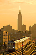 The Number 7 elevated subway near 46th Street in Queens, New York City, with the Empire State Building in the background.