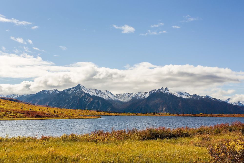 Scenic view of Knob Lake and the Chugach Mountains of the Matanuska Valley in Southcentral Alaska. Autumn. Afternoon.