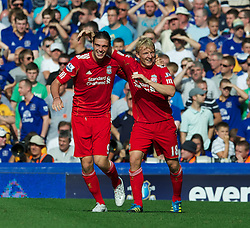 LIVERPOOL, ENGLAND - Saturday, October 1, 2011: Liverpool's Andy Carroll celebrates scoring the first goal against Everton with team-mate Dirk Kuyt during the Premiership match at Goodison Park. (Pic by David Rawcliffe/Propaganda)