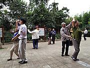 Dancing in Zhuantang park, Kunming, Yunnan.