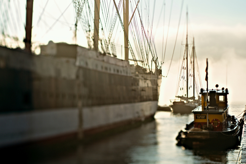 Old sailing vessels and tugboat, South Street Seaport, New York, NY, US