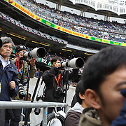 Japanese photographers amongst the media entourage during the New York Yankees V Baltimore Orioles home opening day at Yankee Stadium, The Bronx, New York. 7th April 2014. Photo Tim Clayton