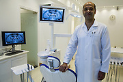 Egyptian dentist Dr. Tamer Farahat poses for a portrait at his office June 17, 2015 in Cairo, Egypt. Dr Farahat's office boasts its own disinfecting room with ultrasonic bath to wash tools, and a high-pressure steam autoclave to sterilize them and prevent Hepatitis C and other blood-borne diseases. Many dental clinics in poorer areas do not have access to such expensive equipment, thus complicating the national fight against Hepatitis C in Egypt. (Photo by Scott Nelson, for the New York Times)