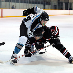 LINDSAY, ON - Feb 21 : Ontario Junior Hockey League Game Action between the Lindsay Muskies and the Pickering Panthers, Keegan Cairns #24 of the Lindsay Muskies Hockey Club makes the hit on Riley Devine #27 of the Pickering Panthers Hockey Club during third period game action.<br /> (Photo by Andy Corneau / OJHL Images)