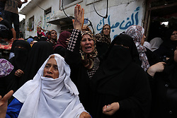August 17, 2017 - Gaza, Palestine - Mourners and Hamas militants carry the body of Nidal al-Jaafari, a 28-year-old field commander who was killed overnight in a suicide attack that targeted Hamas forces near the Gaza Strip's crossing with Egypt, during his funeral in Rafah on August 17, 2017. Hamas's military wing, the Ezzedine al-Qassam Brigades, blamed ''fundamentalist jihadists'' for the attack, but further details on their backgrounds and motivations were still being investigated. (Credit Image: © Majdi Fathi/NurPhoto via ZUMA Press)