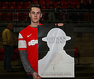 A Leyton Orient fans holds the poster in Leyton Orient's special edition programme to commemorate to mark the 100th anniversary of the start of WWI before the Johnstone's Paint Trophy match at the Matchroom Stadium London,<br /> Picture by David Horn/Focus Images Ltd +44 7545 970036<br /> 11/11/2014