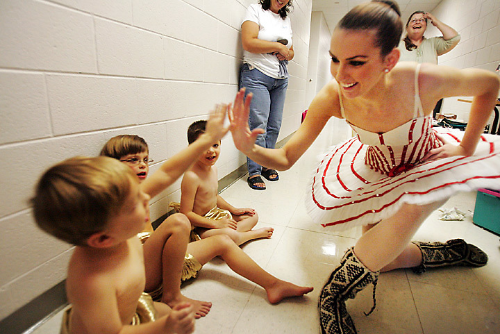 "galmh ""Nutcracker""---Columbia City Ballet dancer Misha Eady high-fives cupid Aiden Camilleri, 4, during rehearsal in Clover. Although stressful, Eady says it's wonderful to work with children and expose them to the arts. ""They're the future of ballet,"" she said."