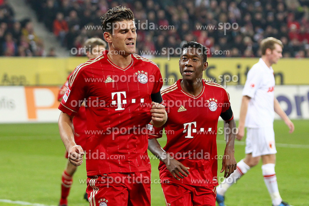 06.11.2011, SGL Arena, Augsburg, GER, 1.FBL, FC Augsburg vs. FC Bayern Muenchen, im Bild  Jubel nach dem 0-1 durch Mario Gomez (Bayern #33) mit David Alaba (Bayern #27) // during the match  FC Augsburg vs. FC Bayern Muenchen , on 2011/11/06, SGL Arena, Augsburg, Germany, EXPA Pictures © 2011, PhotoCredit: EXPA/ nph/  Straubmeier       ****** out of GER / CRO  / BEL ******