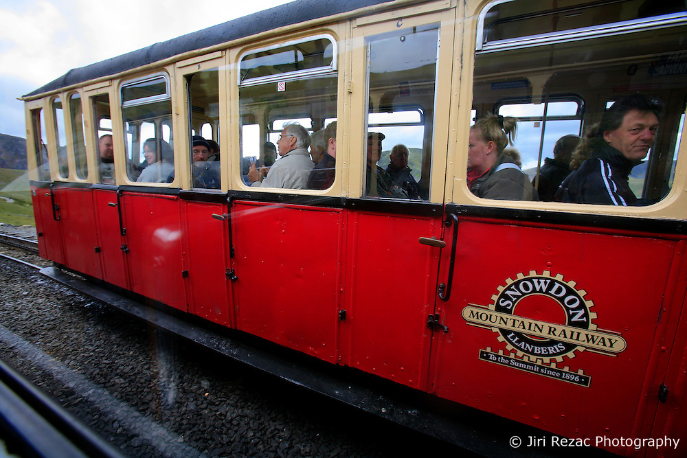 UK WALES LLANBERIS 15JUN08 -  Carriage of the Snowdon en route to the summit. The Snowdon Mountain Railway (Welsh: Rheilffordd yr Wyddfa) is a narrow gauge rack and pinion mountain railway in Gwynedd, north-west Wales. It is a tourist railway that travels for 4.675 miles  (7.524 km) to the summit of Snowdon, the highest peak in Wales. It is the only public rack and pinion railway in the United Kingdom and after more than 100 years of service it remains a highly popular tourist attraction...jre/Photo by Jiri Rezac ..© Jiri Rezac 2008..Contact: +44 (0) 7050 110 417.Mobile:  +44 (0) 7801 337 683.Office:  +44 (0) 20 8968 9635..Email:   jiri@jirirezac.com.Web:    www.jirirezac.com..© All images Jiri Rezac 2008 - All rights reserved.