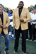 Former St. Louis Rams offensive tackle Orlando Pace looks on during the announcement canceling the game before the Green Bay Packers 2016 NFL Pro Football Hall of Fame preseason football game against the Indianapolis Colts on Sunday, Aug. 7, 2016 in Canton, Ohio. The game was canceled for player safety reasons due to the condition of the paint on the turf field. (©Paul Anthony Spinelli)