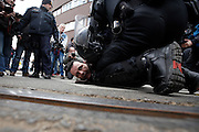 "Police arrest protesters from the Occupy Croatia movement that organized counter-protest against ""the terror of the war veterans protesters in tents""."