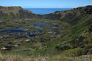 A view across the crater lake of the Rano Kau volcano in Easter Island, out to sea