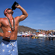 Kyle Henderson parties hard while cruising Lake Havasu and Steamboat Cove. Kyle and friends had a designated driver for the boat.