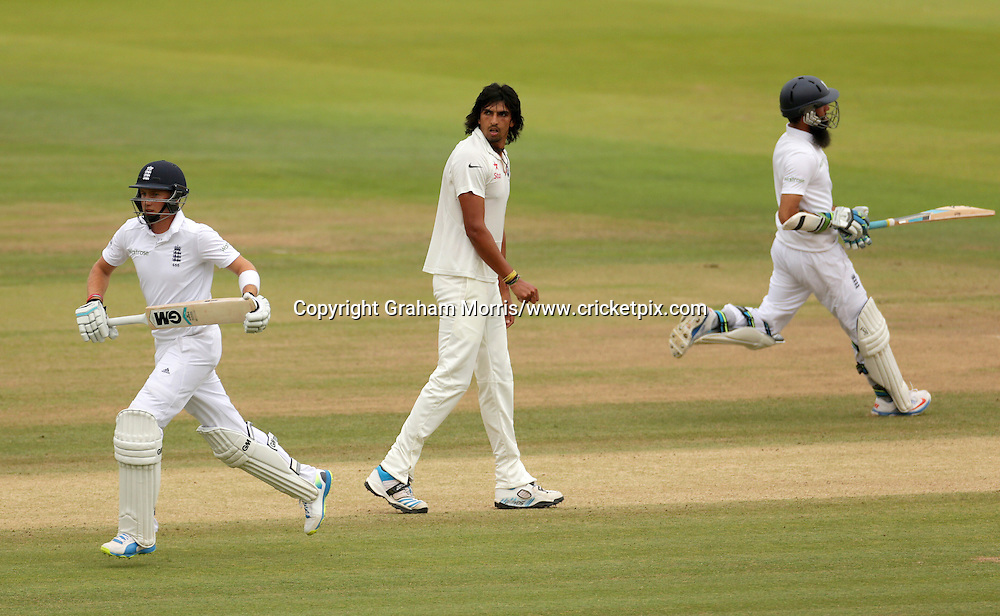 Ishant Sharma watches Joe Root (left) and Moeen Ali run off his bowling during the second Investec Test Match between England and India at Lord's Cricket Ground, London. Photo: Graham Morris/www.cricketpix.com (Tel: +44 (0)20 8969 4192; Email: graham@cricketpix.com) 21/07/14
