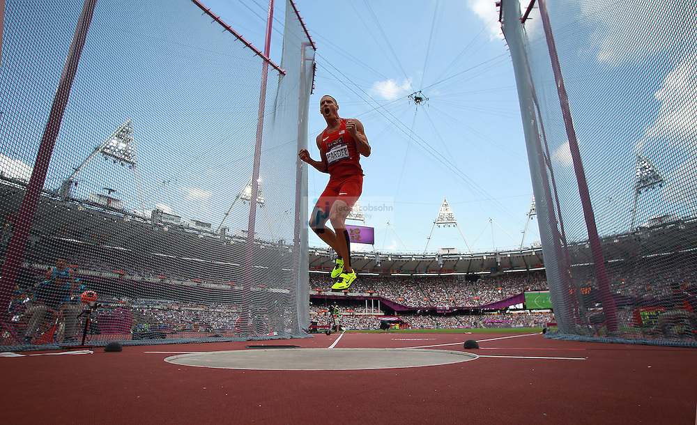 Trey Hardee of the USA celebrates after a throw in the discus portion of the decathlon during track and field at the Olympic Stadium during day 13 of the London Olympic Games in London, England, United Kingdom on August 9, 2012..(Jed Jacobsohn/for The New York Times)..