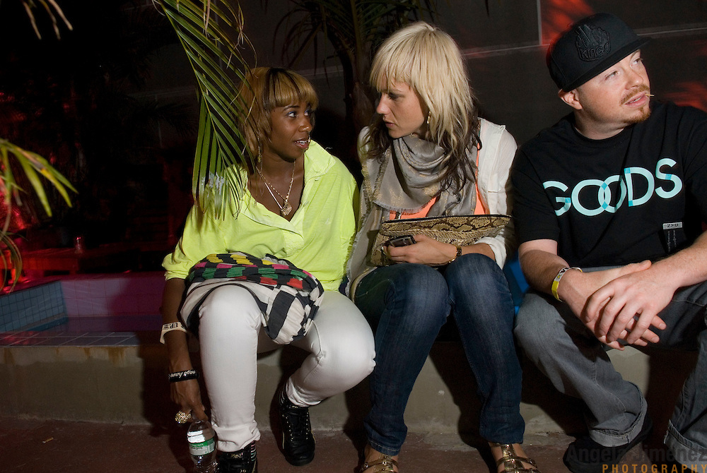 Date: 6/19/08.Desk: STL.Slug: NITE.Assign Id: 30063895A..Santi White, left, aka the singer Santigold, talks with her friends Craig Wetherby, a photographer, right, and April Roomet, a stylist, center, at Studio B in Greenpoint, Brooklyn on June 19, 2008. ....Photo by Angela Jimenez for The New York Times .photographer contact 917-586-0916
