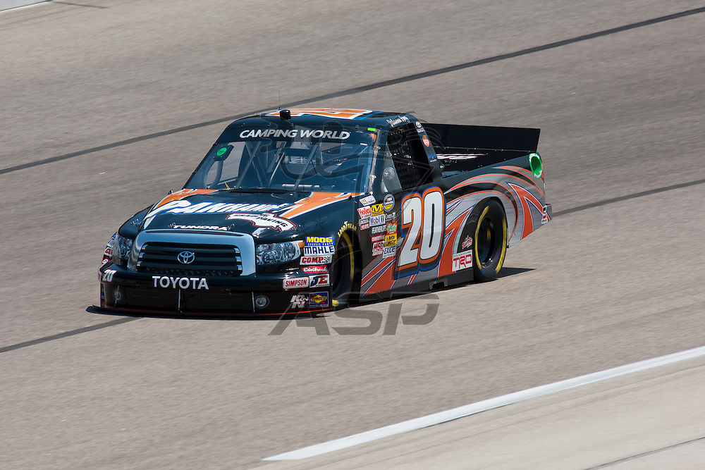 Fort Worth, TX - June 09, 2011:  Johanna Long (20) brings her Camping World Truck Series truck through the turns during a practice session for the WinStar World Casino 400 race in Fort Worth, TX.