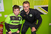 Forest Green Rovers goalkeeper Lewis Ward(34) with FGR Ambassador during the EFL Sky Bet League 2 match between Forest Green Rovers and Carlisle United at the New Lawn, Forest Green, United Kingdom on 16 March 2019.