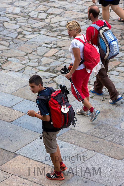 Pilgrims end their pilgrimage in Cathedral square of Santiago de Compostela, Galicia, Spain
