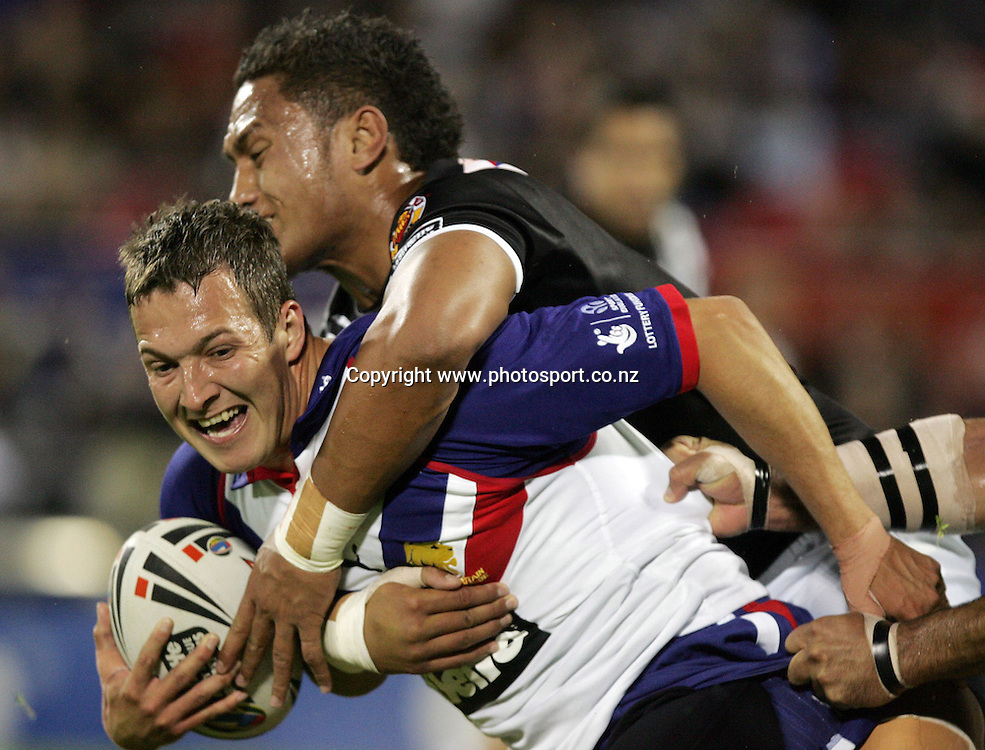 Danny Mcguire is brought down by Manu Vatuvei during the Gillette Tri Nations rugby league match between the New Zealand Kiwis and Great Britain at Jade Stadium, Christchurch, New Zealand on Saturday 28 October, 2006. Photo: Hannah Johnston/PHOTOSPORT<br /> <br /> <br /> <br /> 281006