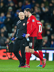 CARDIFF, WALES - Tuesday, February 11, 2014: Cardiff City's Jordon Mutch walks off injured with physiotherapist Sean Connelly against Aston Villa during the Premiership match at the Cardiff City Stadium. (Pic by David Rawcliffe/Propaganda)