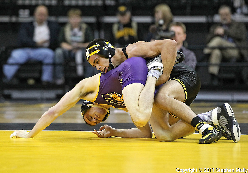 December 8, 2011: Iowa Hawkeyes Tony Ramos tries to turn Northern Iowa Panthers Ryan Jauch in the 133 pound bout of the NCAA wrestling dual between the Northern Iowa Panthers and the Iowa Hawkeyes at Carver-Hawkeye Arena in Iowa CIty, Iowa on Thursday, December 8, 2011. Ramos defeated Jauch 15-5 and Iowa defeated Northern Iowa 38-4.