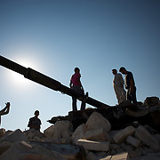 August 17, 2012 - Marea, Aleppo, Syria: People check the rubble of a destroyed mosque in central Azaz. Syrian warplanes delivered, two days ago, a massive airstrike to the center of the town, causing more the thirthy deaths and around two hundred wounded. (Paulo Nunes dos Santos/Polaris)