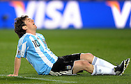 Argentina's forward Lionel Messi lies on the field in pain during the World Cup South Africa 2010 soccer match against Nigeria, at Soccer City stadium, in Johannesburgo, South Africa, on June 12, 2010.  (Alejandro Pagni/PHOTOXPHOTO)