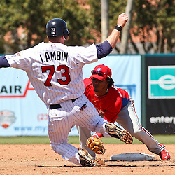 March 13, 2011; Fort Myers, FL, USA; Philadelphia Phillies shortstop Michael Martinez (19) tags out Minnesota Twins right fielder Chase Lambin on an attempted steal at second base during a spring training exhibition game at Hammond Stadium.   Mandatory Credit: Derick E. Hingle