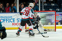 KELOWNA, CANADA - FEBRUARY 16: Leif Mattson #28 of the Kelowna Rockets misses a goal on David Tendeck #30 of the Vancouver Giants during first period on February 16, 2019 at Prospera Place in Kelowna, British Columbia, Canada.  (Photo by Marissa Baecker/Shoot the Breeze)