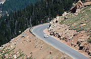 COLORADO SPRINGS - JUNE 27:  Nobuhiro Tajima #1 drives a 2009 Suzuki SX4 in the Unlimited Division as he races 12.42 miles up to the 14,110 foot summit of Pikes Peak Mountain in Pike National Forest during the 88th running of the Pikes Peak International Hill Climb, the second oldest motor sports event in the United States, on June 27, 2010 in Colorado Springs, Colorado. ©Paul Anthony Spinelli