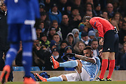 Manchester City defender Nicolas Otamendi (30)  goes off injured during the Champions League Round of 16 match between Manchester City and Dynamo Kiev at the Etihad Stadium, Manchester, England on 15 March 2016. Photo by Simon Davies.