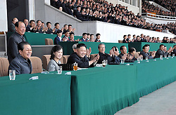 59584166 .The photo provided by KCNA on April 30, 2013 shows top leader of the Democratic Peoples Republic of Korea (DPRK) Kim Jong Un (3rd L Front), accompanied by his wife Ri Sol Ju (2nd L Front), watching a football match in Pyongyang, capital of the DPRK, on April 29, 2013, 30, April 2013. Photo by: i-Images.UK ONLY