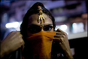 "Chabbo, age 32, dancer and transvestite, after a performance lasted the whole night at a wedding party. Early morning in Lahore, Pakistan on Wednesday, December 03 2008.....""Not men nor women"". Just Hijira, Kusra. Painted lips, Kajal surrounding their eyes and colourful veils..Pakistan is today considered a strongly, foundamentalist as well, islamic country. But under its reputation, above all over the talebans' continuos advancing, stirs a completely extraneous world, a multiethnic mixed society. Transvestites make part of it, despite this would not be admitted by a strict law. Third gender, the Hijira are born as men (often ermaphrodites) or with an ambiguous genital situation, and they have their testicles and penis removed through a - often brutal - surgical operation. The peculiarity is that this operation does not contemplate the reconstruction of a female organ. This is the reason why they are not considered as men nor women, just Hijira. They are often discriminated, persecuted  and taxed with being men prostitutes in the muslim areas. The members of this chast perform dances during celebrations, especially during weddings, since it is anciently believed that an EUNUCO's dance and kiss in the wedding day brings good luck to the couple's fertility...To protect the identities of the recorded subjects names and specific .places are fictionals."