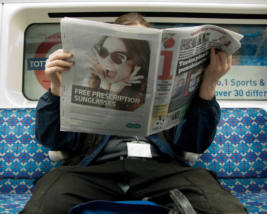 Portrait of a man on the London Underground Network reading a newspaper