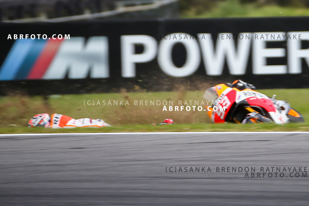 October 19, 2014: Marc Marquez riding for Repsol Honda Team  crashes out during the 2014 MotoGP of Australia at Phillip Island Grand Prix Circuit on October 19, 2014 in Phillip Island, Australia. Photo Asanka Brendon Ratnayake