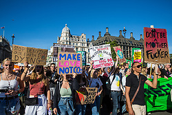 London, UK. 20 September, 2019. Students and climate campaigners march through Parliament Square during the second Global Climate Strike in protest against a lack of urgent action by the UK Government to combat the global climate crisis. The Global Climate Strike grew out of the Fridays for Future movement and is organised in the UK by the UK Student Climate Network.