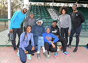 Athletes pose with coach Brooks Johnson during a workout in Kissimmee, Fla., Thursday, Jan. 25, 2018. From left: Andrew Riley, Elise Anderson, Francena McCorory, Johnson, Shayla Sanders, Odean Skeen, Gabrielle Farquharson and Andrew Riley.