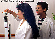 Medical doctor, physician at work African American Nurse Weights Female Hispanic at Urban Clinic