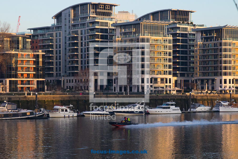 A motor boat dashes along the River Thames in the early morning light, London <br /> Picture by Paul Davey/Focus Images Ltd +447966 016296<br /> 24/02/2016