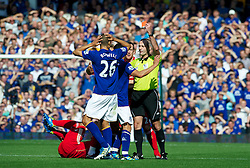 LIVERPOOL, ENGLAND - Saturday, October 1, 2011: Everton's Jack Rodwell is shown the red card and sent off by referee Martin Atkinson after a tackle on Liverpool's Luis Alberto Suarez Diaz during the Premiership match at Goodison Park. (Pic by David Rawcliffe/Propaganda)
